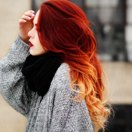 mechas en cabello rojizo