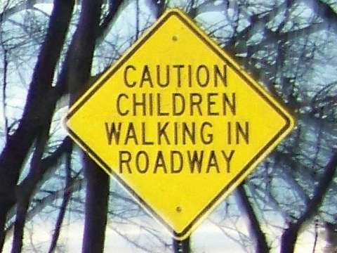 64TH_ST_NOTICE_SIGN_BECAUSE_THERE_ISN'T_ANY_SIDEWALKS_CHILDREN_WALK_IN_ROADWAY