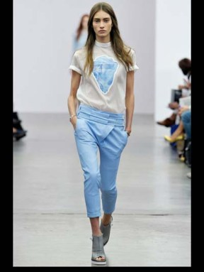 blue pants and top model on a runway