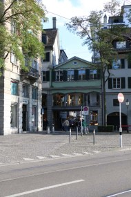 A photograph of green old building in Zurich Altstadt old town first district