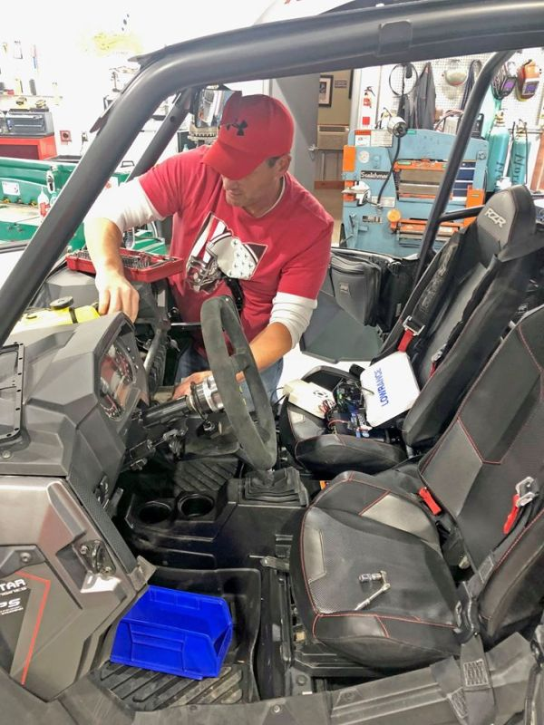 Razorback Offroad employees working on the Polaris RZR XP Turbo S custom build