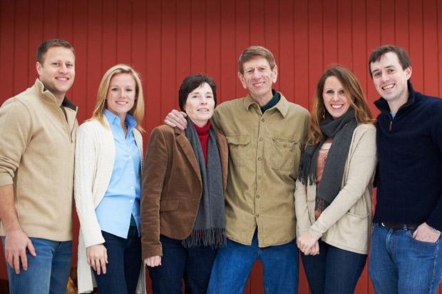 Cedar Rapids family photographer posing the family for an outdoor shoot