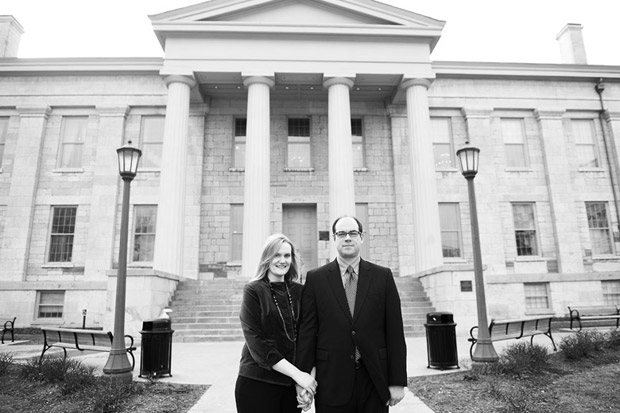 Couple holding hands in front of the Old Capitol in Iowa City