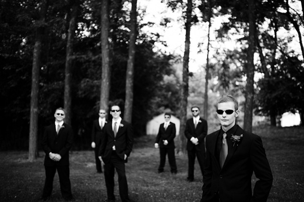 groom posing with the groomsmen