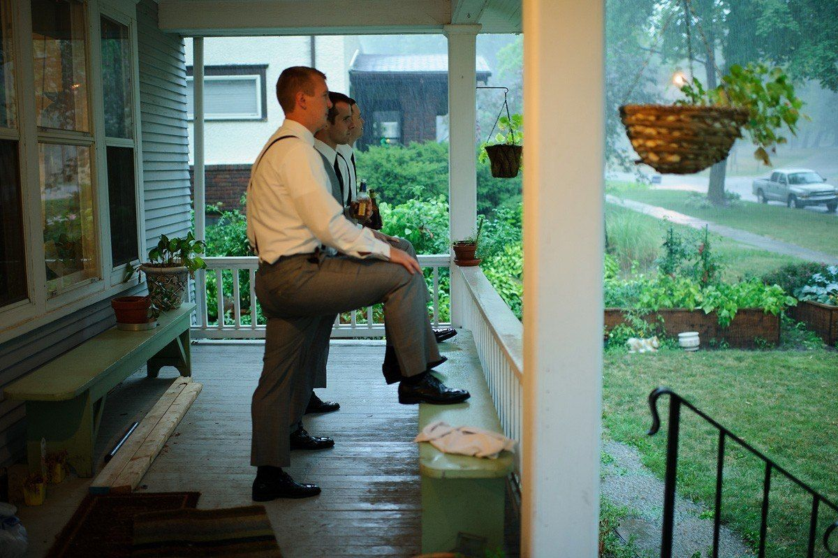 groom with groomsmen on the porch