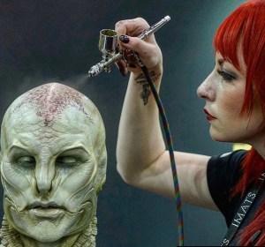 Chloe Sens applying RBFX prosthetics on Gordon Tarpley