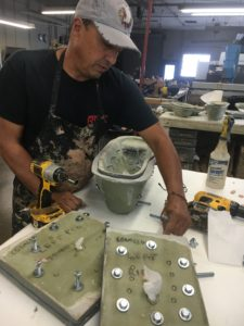 Mitch Duran prepping molds before injection