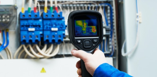 Image of infrared thermography being performed on an electrical system control