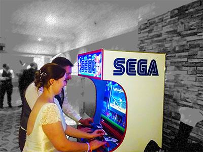 Bride and Groom playing sega arcade games for weddings