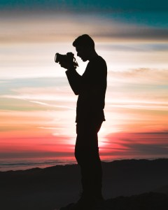 Photographer's silhoutte against setting sun