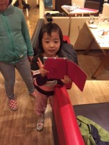 4 year-old likes iPad and peace sign