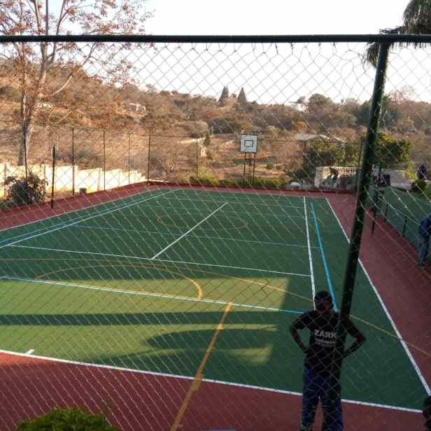 3a. Basketball court and fence after renovations