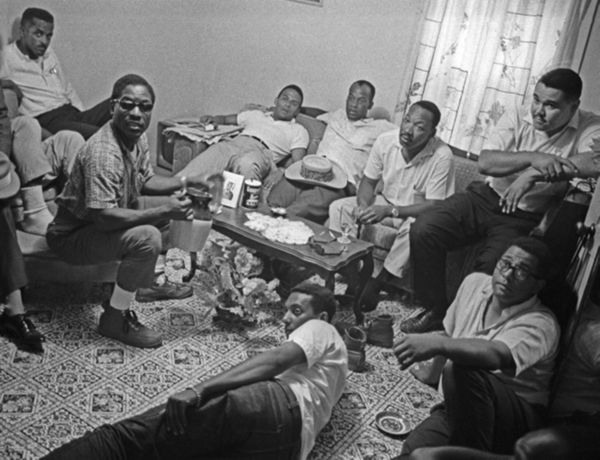 Following Carmichael's release from jail, march leadership discusses issue of Black Power; unidentified man, Bernard Lee, Andrew Young, Robert Greene, Martin Luther King Jr., Lawrence Guyot, Harry Bowie, and Stokely Carmichael. Photo by Bob Fitch from the Stanford archives.