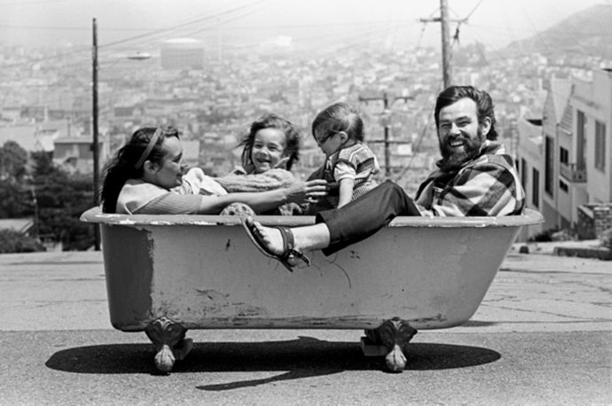 Family sits in a bathtub together on a street in San Francisco