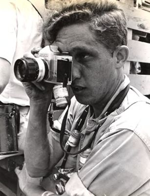 Photo of photographer Bob Fitch with a camera