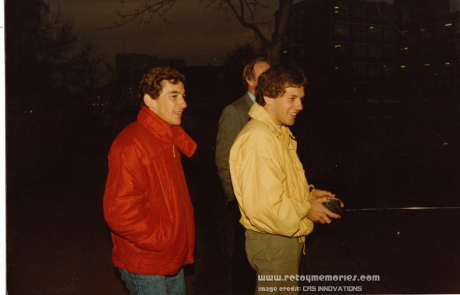 Ayrton Senna and Mauricio Gugelmin controlling Ayrton's JPS livery Asahi R/C Boat, 1986