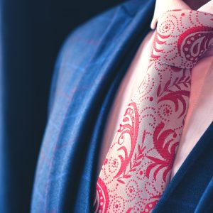 White and pink necktie with red paisley pattern