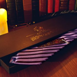 Purple tie with black stripes