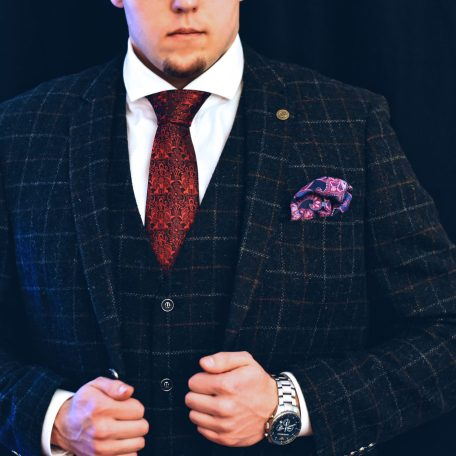 Elegant black checked suit, red floral tie and pink hanky