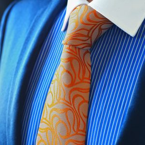 Orange ornamental patterned silk necktie