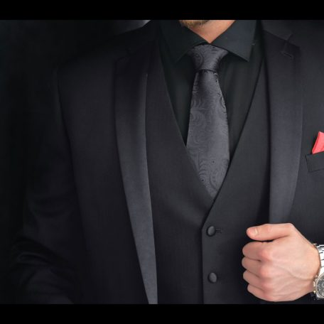 Silk black tie and red burgundy pocket square