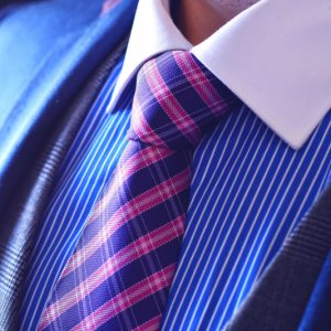 Luxurious checked silk necktie of blue and pink color