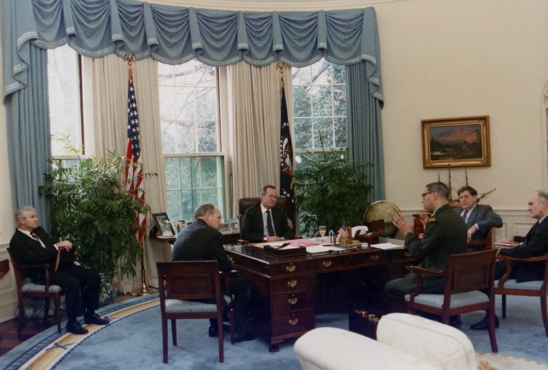 President Bush meets with members of his cabinet in the Oval Office.