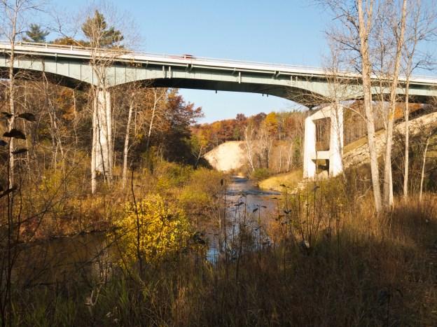 The Pine River as it passes under Peterson Bridge at M-37