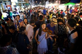 Loved watching this precious girl make music in a packed night Market in Chiang Mai, Thailand