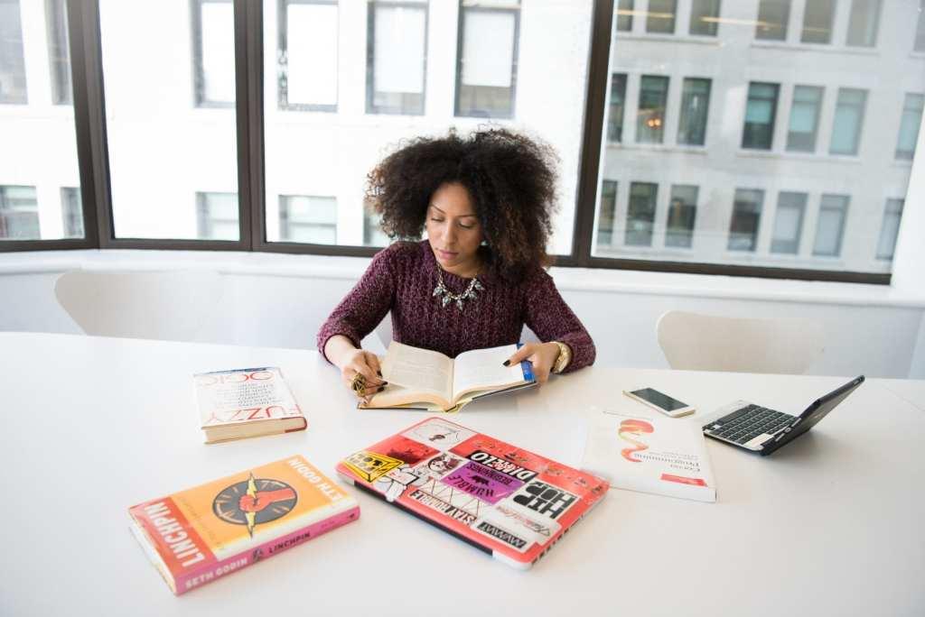 Woman Reading BCBS Info
