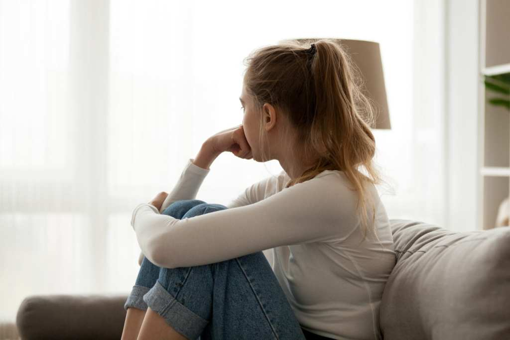 Depressed girl before treatment