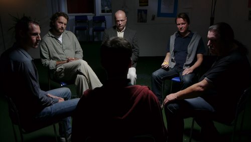 An addiction support group meeting