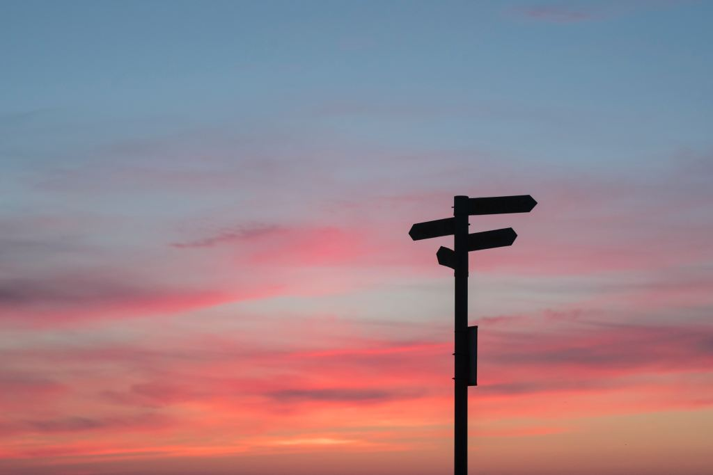 A signpost pointing different ways