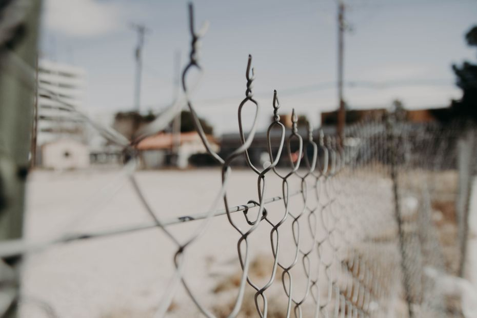 A chain-link fence. Is it keeping people out or keeping them in?