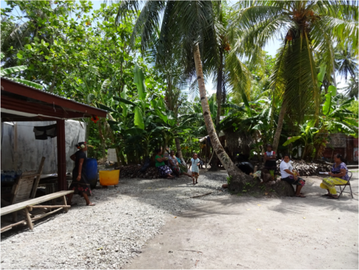 photo credit: Jamie Thomas Micronesians sit near the community nas on their island.