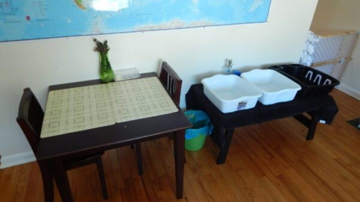 A child's table, next to a dishwashing station.