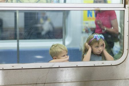 Two kids on train