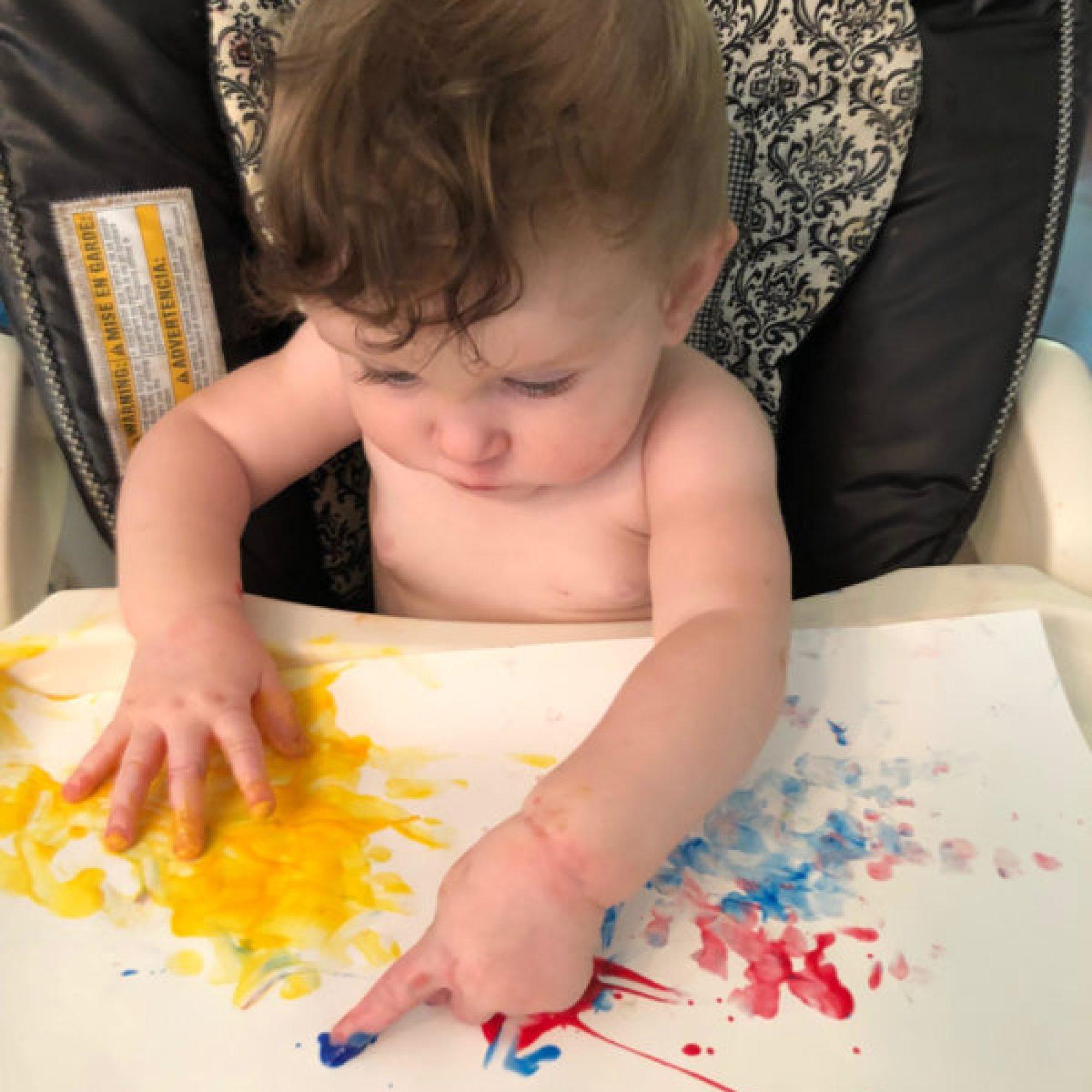 baby fingerpainting to improve fine motor skills