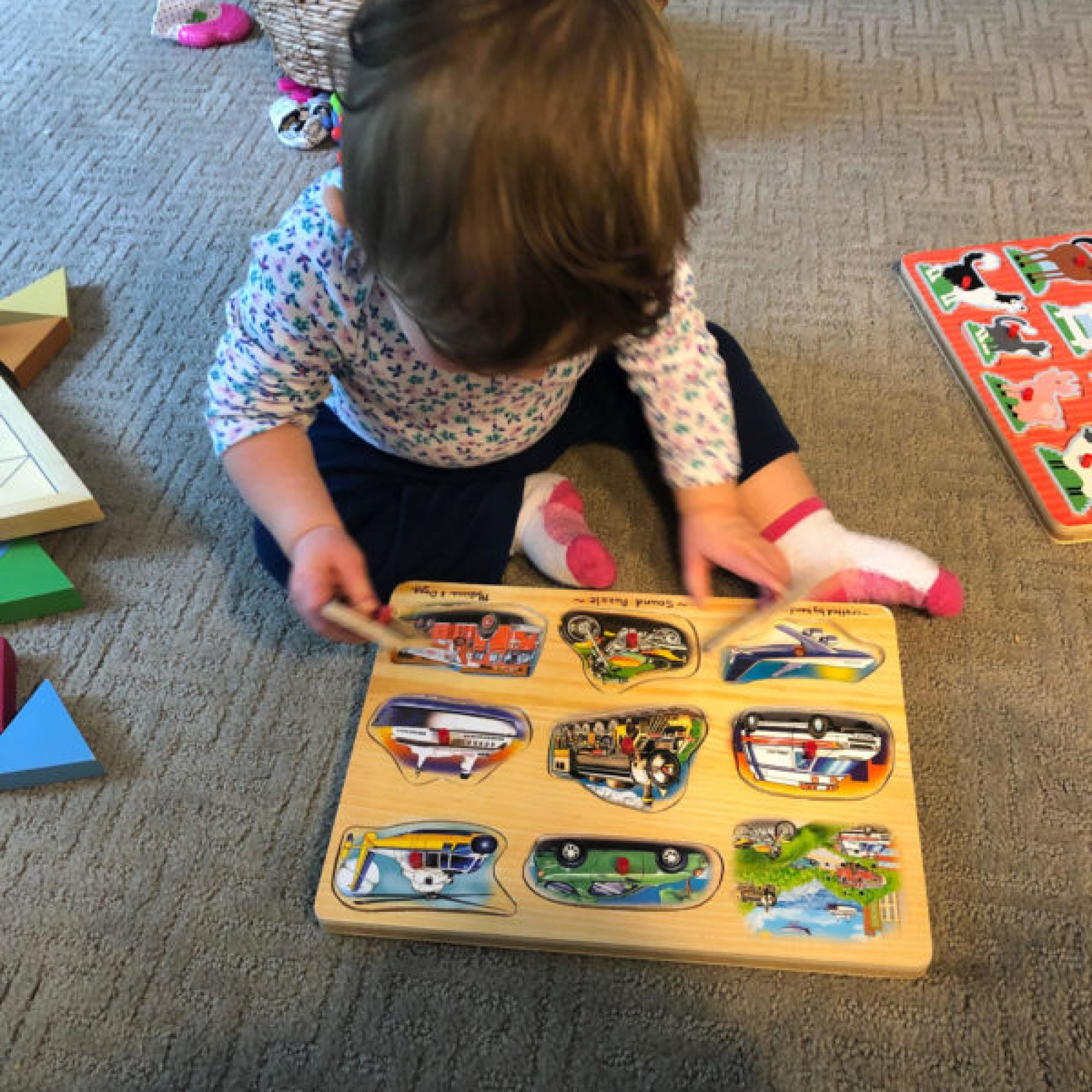 Baby doing puzzle to improve fine motor skills