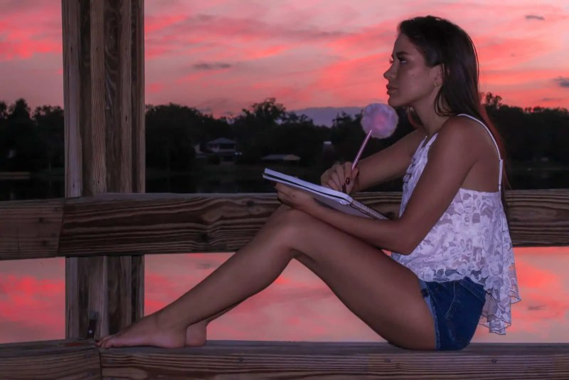 How This Blog Works - Girl Thinking Writing Journal Sunset