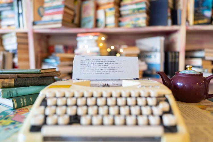 Books, typewriter and tea