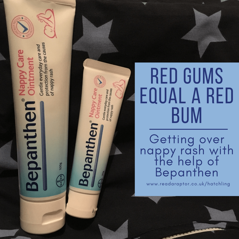 Two tubes of bepanthen nappy care ointment on a blue star background with caption of red gums equal a red bum. getting over nappy rash with the help of Bepanthen