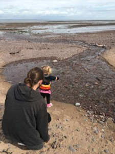 Skimming stones on the beach at Butlin's Just For Tots in Minehead