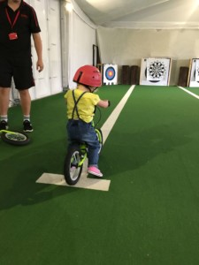 Riding a balance bike at Butlin's Just For Tots in Minehead