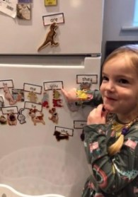 Spike pointing out her phonics words