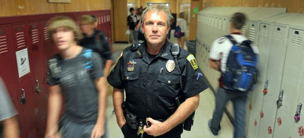 Officer in school. (photo: Billings Gazette)