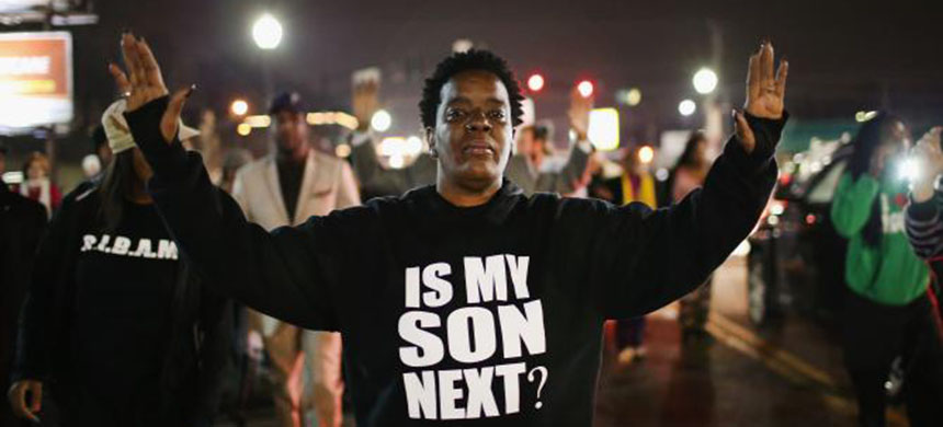 Demonstrators protest in front of the police station in Ferguson, Missouri. (photo: Scott Olson/Getty Images)