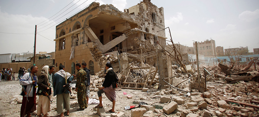 Shiite rebels known as Houthis, gather at houses destroyed by a Saudi-led airstrike in Sanaa, Yemen, July 3, 2015. (photo: Hani Mohammed/AP)