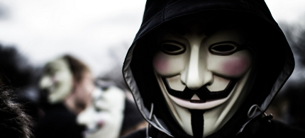 Anonymous members gather at a public demonstration. The mask of Guy Fawkes is a symbol of the movement. (photo: Getty Images)