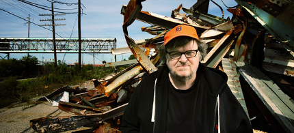 The filmmaker Michael Moore, near a closed factory in Flint, Mich., where his father worked. (photo: Fabrizio Costantini/NYT)